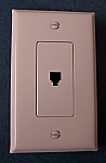 Wall socket cable outlet for telephone connector and almond finish
