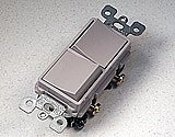 Electrical supplies in a double stack switch receptacle